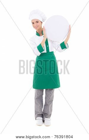 Young Chef Woman In Uniform Holding Big  Empty Plate With Copyspace Isolated On White