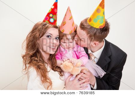 Parents And Daughter In Party Hats