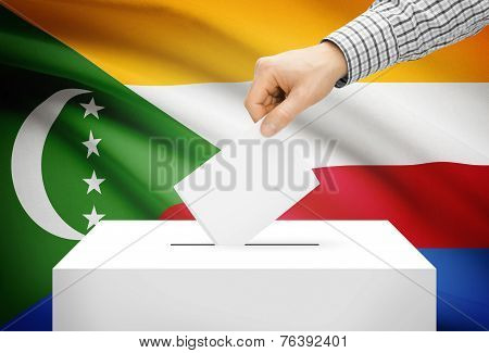 Voting Concept - Ballot Box With National Flag On Background - Comoros