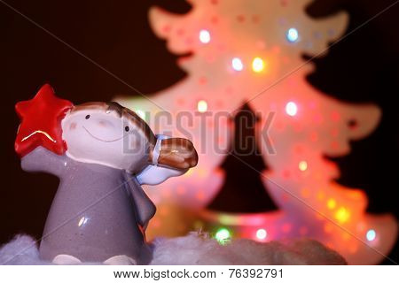 Smiling Christmas angel with a star
