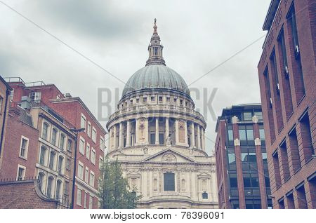 View of the exterior of the domed roof of St Pauls Catherdral between highrise buildings in central London, England