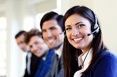 picture of telephone operator  - Cheerful young businesspeople and colleagues in a call center office - JPG