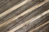 pic of slit  - Slits of sunlight on wooden floorboards creating an abstract background - JPG