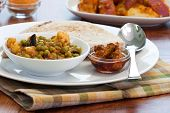 picture of indian food  - Delicious dish of vegetable curry made with peas eggplant cauliflower tomatoes sauce  - JPG