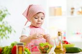 picture of healthy eating girl  - cook kid girl preparing healthy food vegetables - JPG