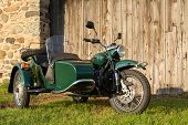 picture of fieldstone-wall  - Sidecar motorcycle in front of fieldstone and weathered wood background - JPG