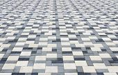 image of paving stone  - Sidewalk in the park is paved with multicolored stone blocks - JPG