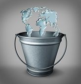 stock photo of bucket  - Global water concept as a group of water splash drops entering a metal bucket shaped as a world map as a symbol for economic funding as a drop in the bucket - JPG