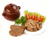 pic of pot roast  - roast with greens bread and tomato in a brown clay pot - JPG