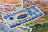 stock photo of dong  - Different Vietnam dong banknotes on a desk - JPG