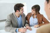 pic of rental agreement  - Young couple in real estate agency signing property agreement - JPG