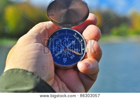 Walking With A Compass In His Hand.