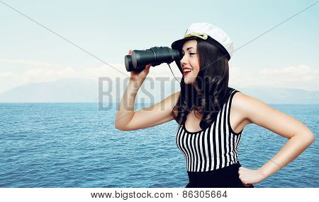 Pretty Smiling Woman Of A Sailor Looking Through Binoculars