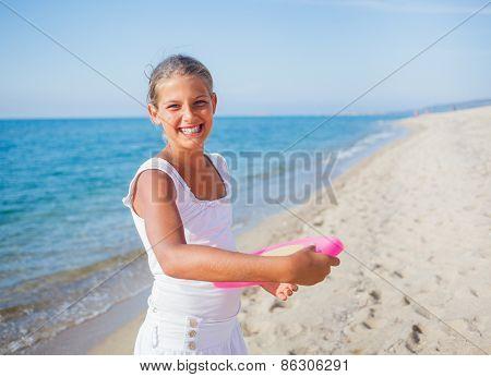 Girl playing frisbee