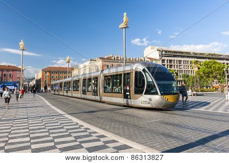 NICE, FRANCE - OCTOBER 2, 2014: Nice tramway at Place Massena, the main pedestrian square of the city. The tramway cars are unique and have been designed to blend with surrounding architecture and art