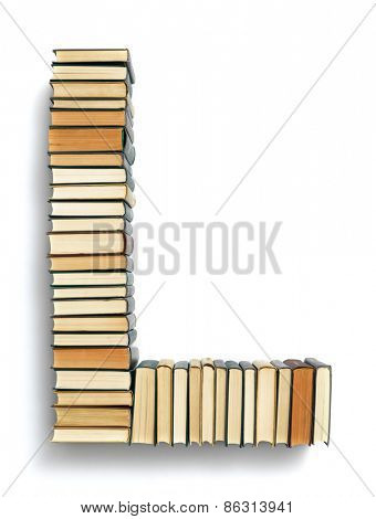 Letter L formed from the page ends of closed vintage hardcover books standing on a white background from a set or series of numbers