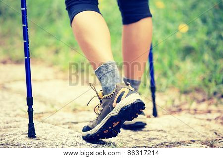 woman hiker hiking at stone trail