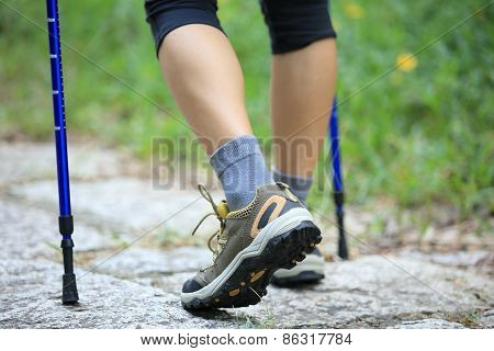 woman hiker hiking at stone trail