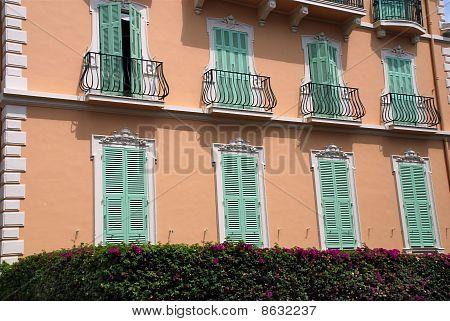 Green Window Shutter On Luxury House