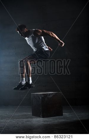 Athlete gave exercise. Jumping on the box. Phase touchdown.