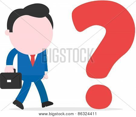 Businessman Walking To Question Mark