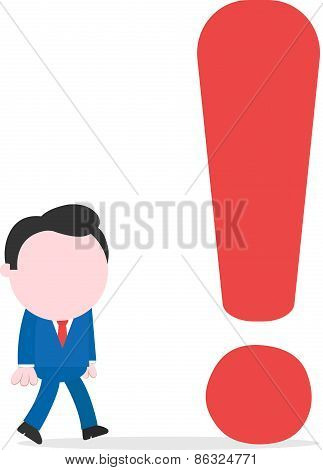 Businessman Walking To Big Exclamation Mark