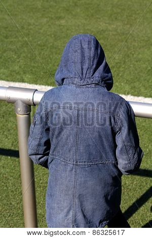A Person In A Jacket With A Hood
