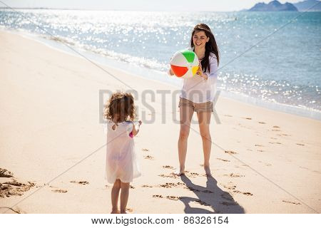 Mom And Daughter Playing Ball