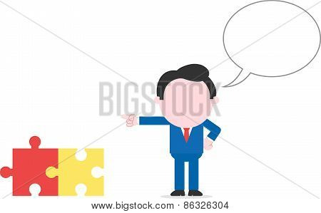 Businessman Pointing Puzzle Pieces
