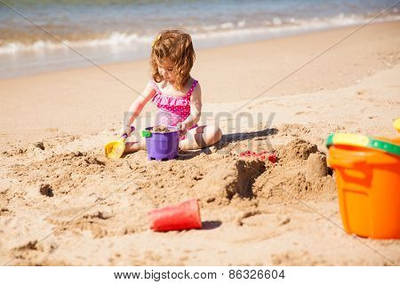 Little Girl Building Sand Castle
