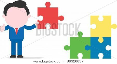 Businessman Holding Puzzle Beside Three Puzzle Pieces