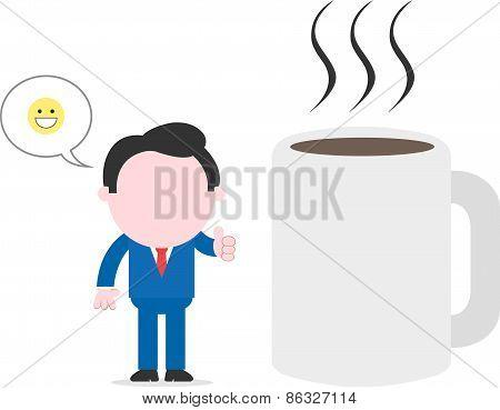 Happy Businessman Beside Huge Coffee Mug