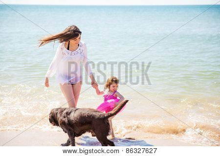 Small Family At The Beach