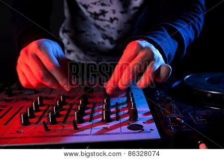 Disc Jockey Mixing Music