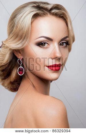 Glamour portrait of beautiful woman model with fresh daily makeup and romantic wavy hairstyle.