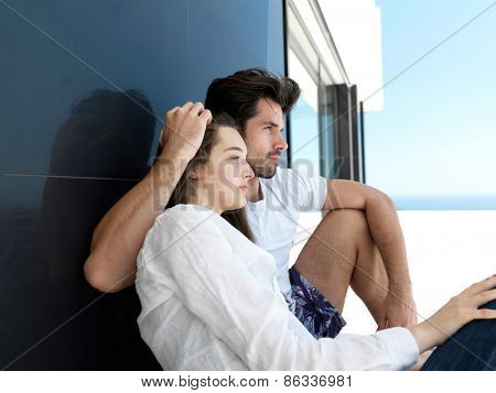 cheerful happy young couple making selfie together at home