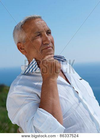Portrait of senior man sitting outside