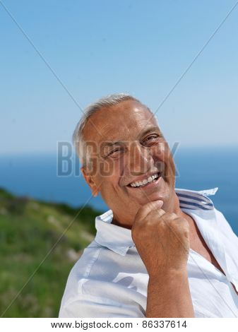 Portrait of senior man sitting outside