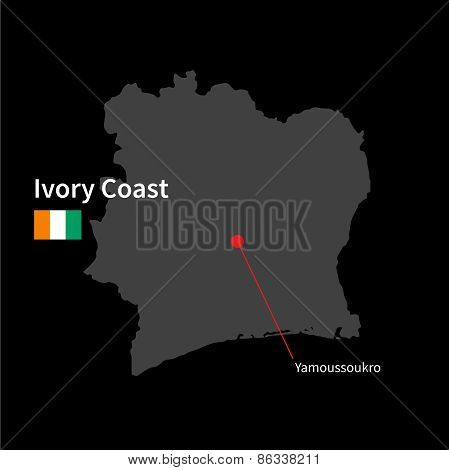 Detailed map of Ivory Coast and capital city Yamoussoukro with flag on black background
