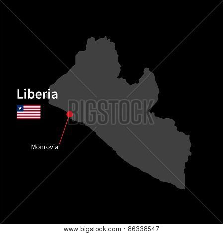 Detailed map of Liberia and capital city Monrovia with flag on black background