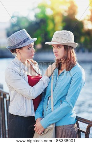 Young Beautiful Woman Comforting Her Friend In The City