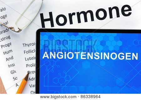 Papers with hormones list and tablet  with word angiotensinogen.