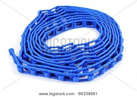 a rolled blue plastic flat chain on a white background