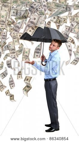 Businessman standing in the rain of money