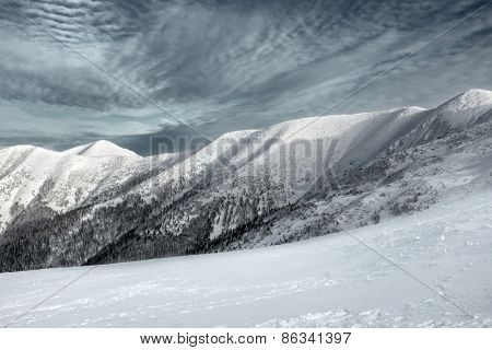 Beautiful mountains view at winter under sky.