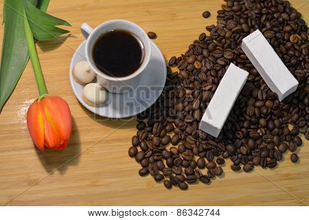 Cup Of Hot Mocca Coffee With Vanilla Pastille On Coffee Beans