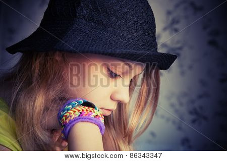 Profile Portrait Of Beautiful Blond Teenage Girl In Black Hat