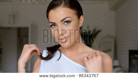 Close up Attractive Young Woman  Wearing Off Shoulder Outfit  Touching her Bare Shoulder While Looking at the Camera.