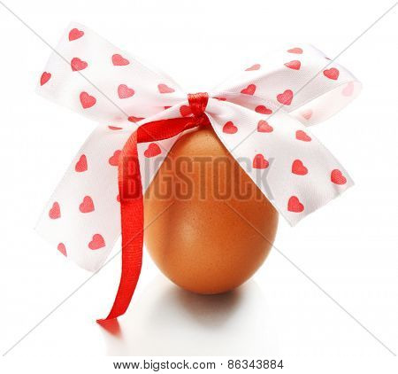 Easter egg with color ribbon bow isolated on white