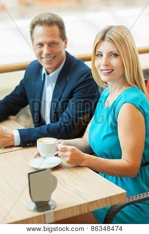 Couple In Coffee Shop.